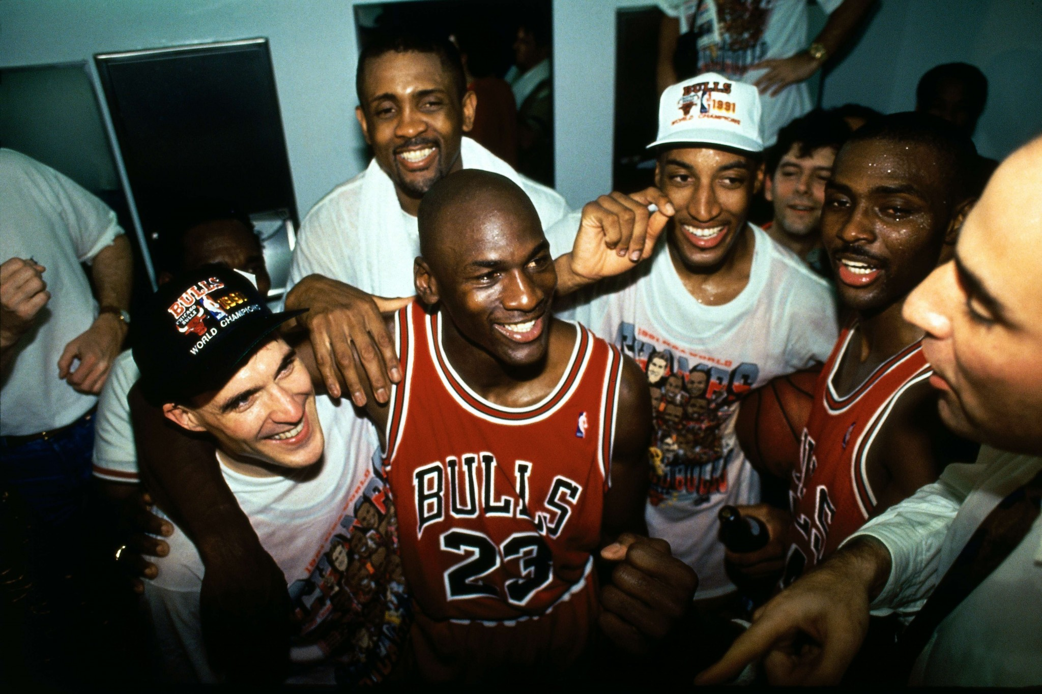 1991-06-12 - Gm 5 v LAL - 1991 NBA Finals - Locker Room Celebration - MJ-Pax-Cartwright (NBAE Andrew Bernstein)
