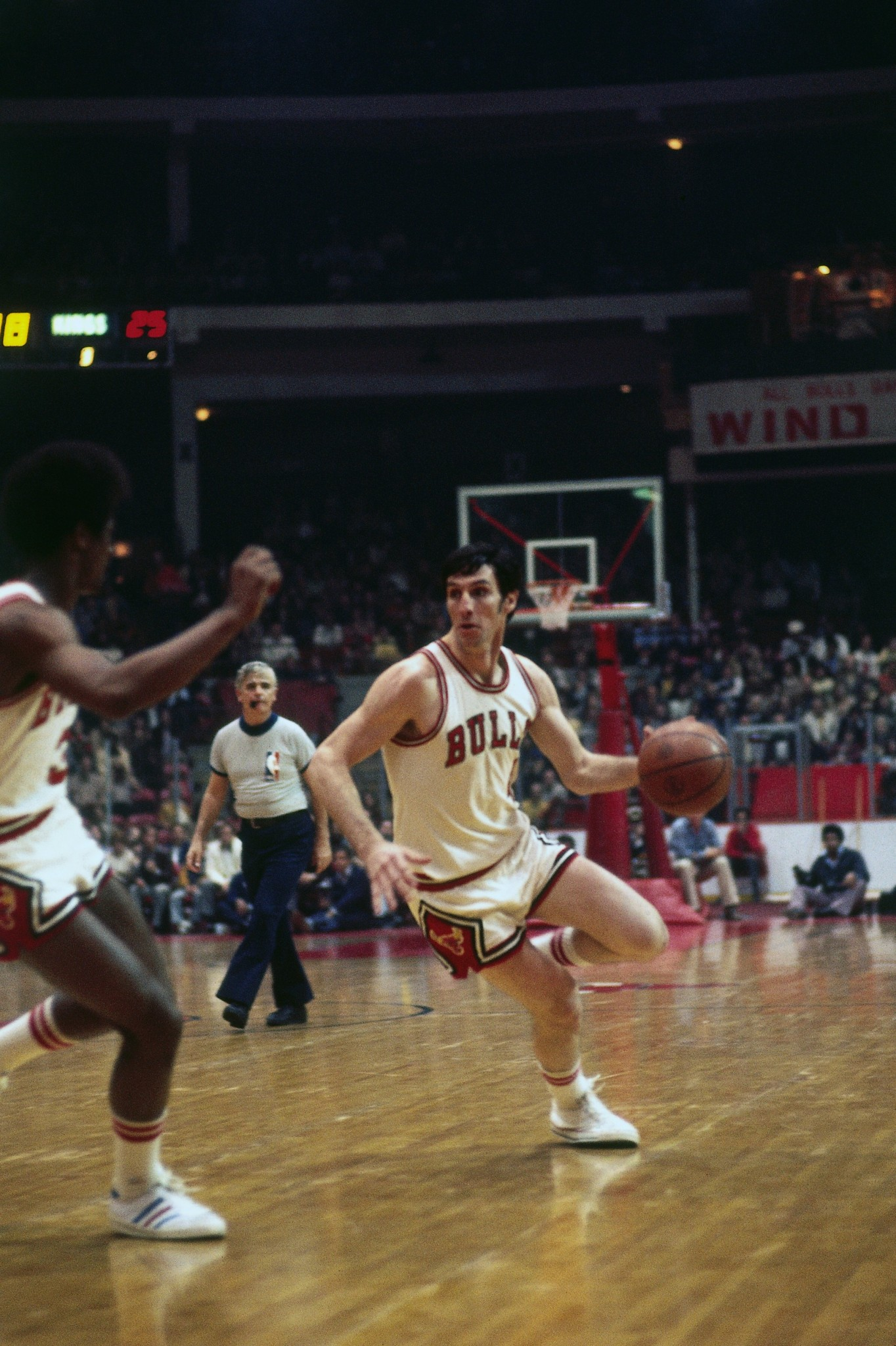 Jerry Sloan with the basketball