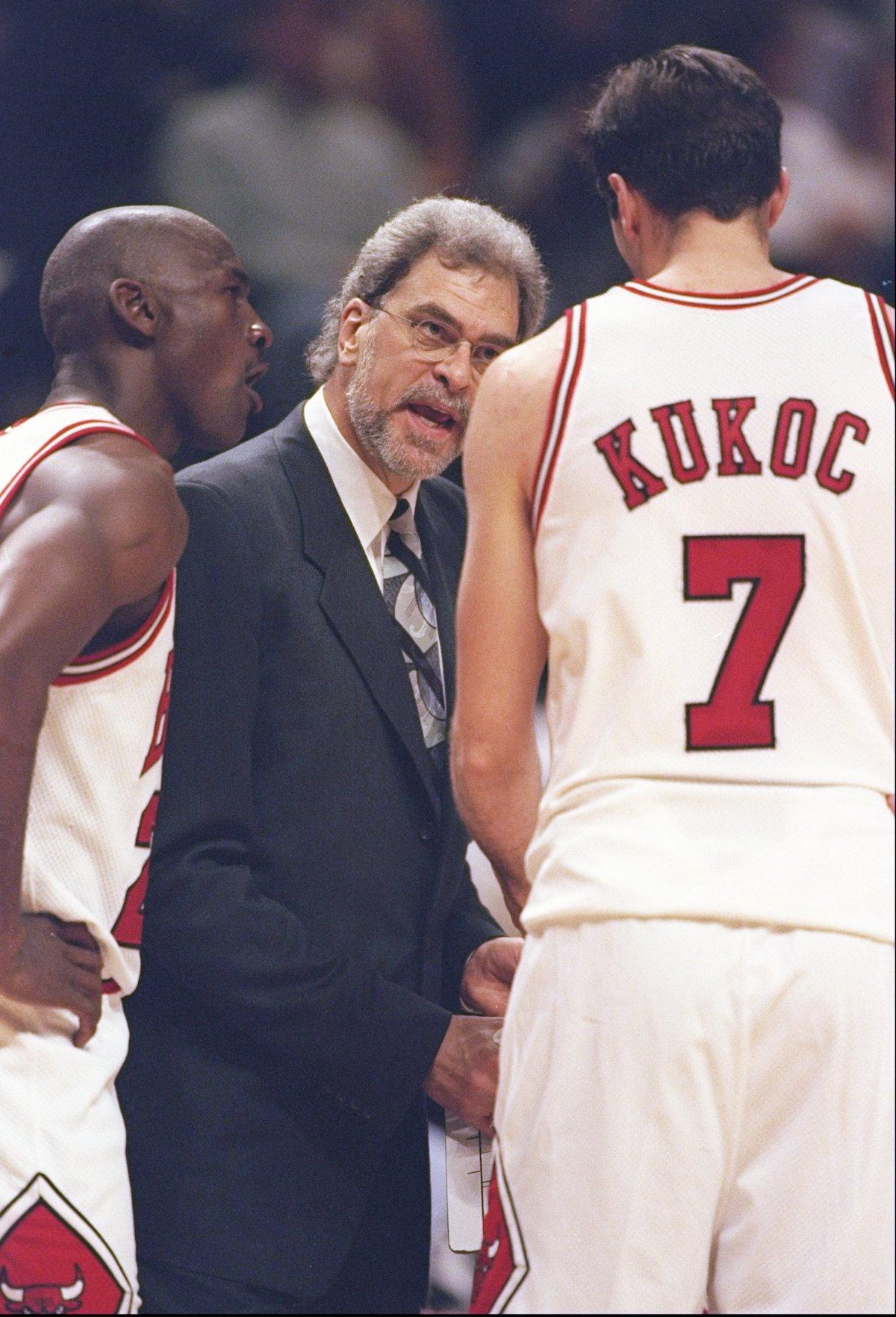 1997 – Coach Phil Jackson speaks to guards Toni Kukoc and Michael Jordan
