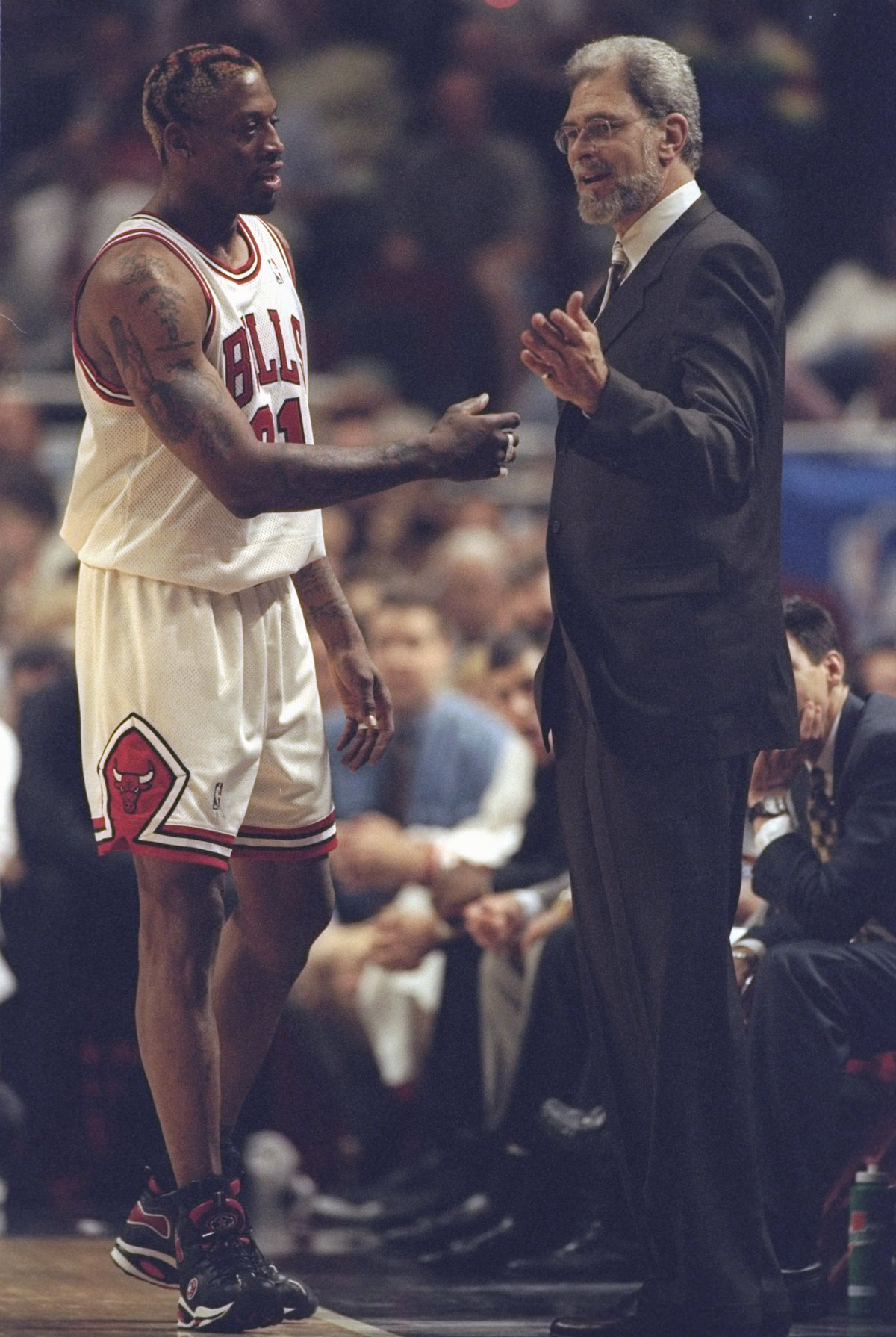 27 May 1998: Dennis Rodman #91 discusses a play with Chicago Bulls head coach Phil Jackson during an Eastern Conference Final game against the Indiana Pacers at the United Center in Chicago, Illinois. The Bulls defeated the Pacers 106-87.