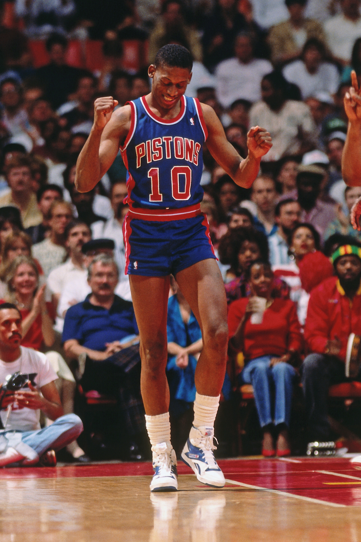 1990 - Dennis Rodman #10 of the Detroit Pistons celebrates in a game against the Atlanta Hawks