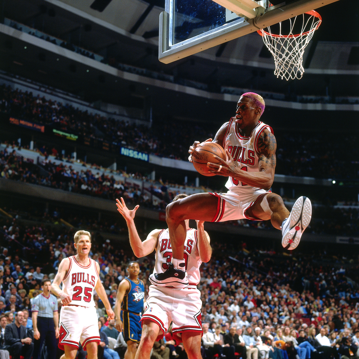 Dennis Rodman #91 of the Chicago Bulls rebounds during a game played on March 22, 1997 at the United Center in Chicago, Illinois.