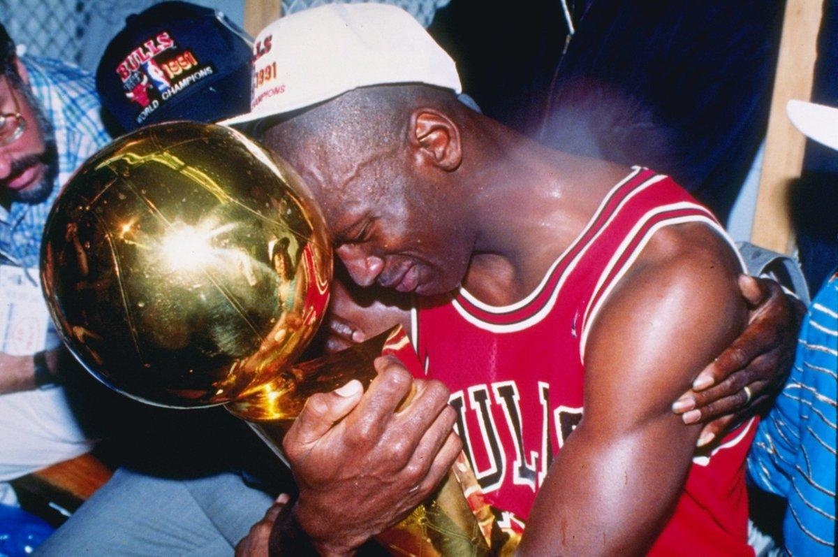 Jordan embracing the Larry O'Brien Trophy after the 1991 NBA Finals