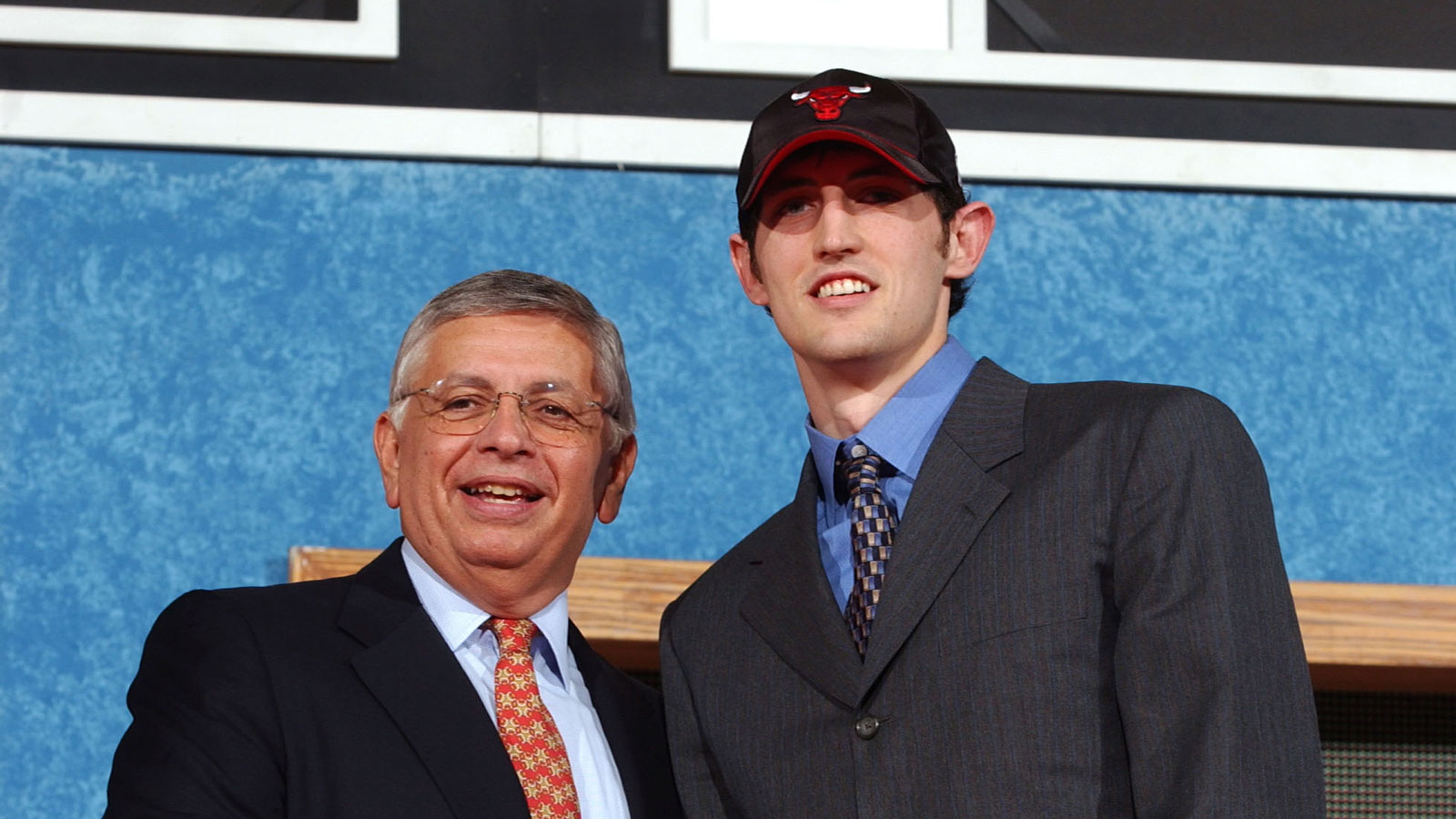 Kirk Hinrich posing for a photo with former NBA Commissioner David Stern after being drafted by the Bulls in 2003.