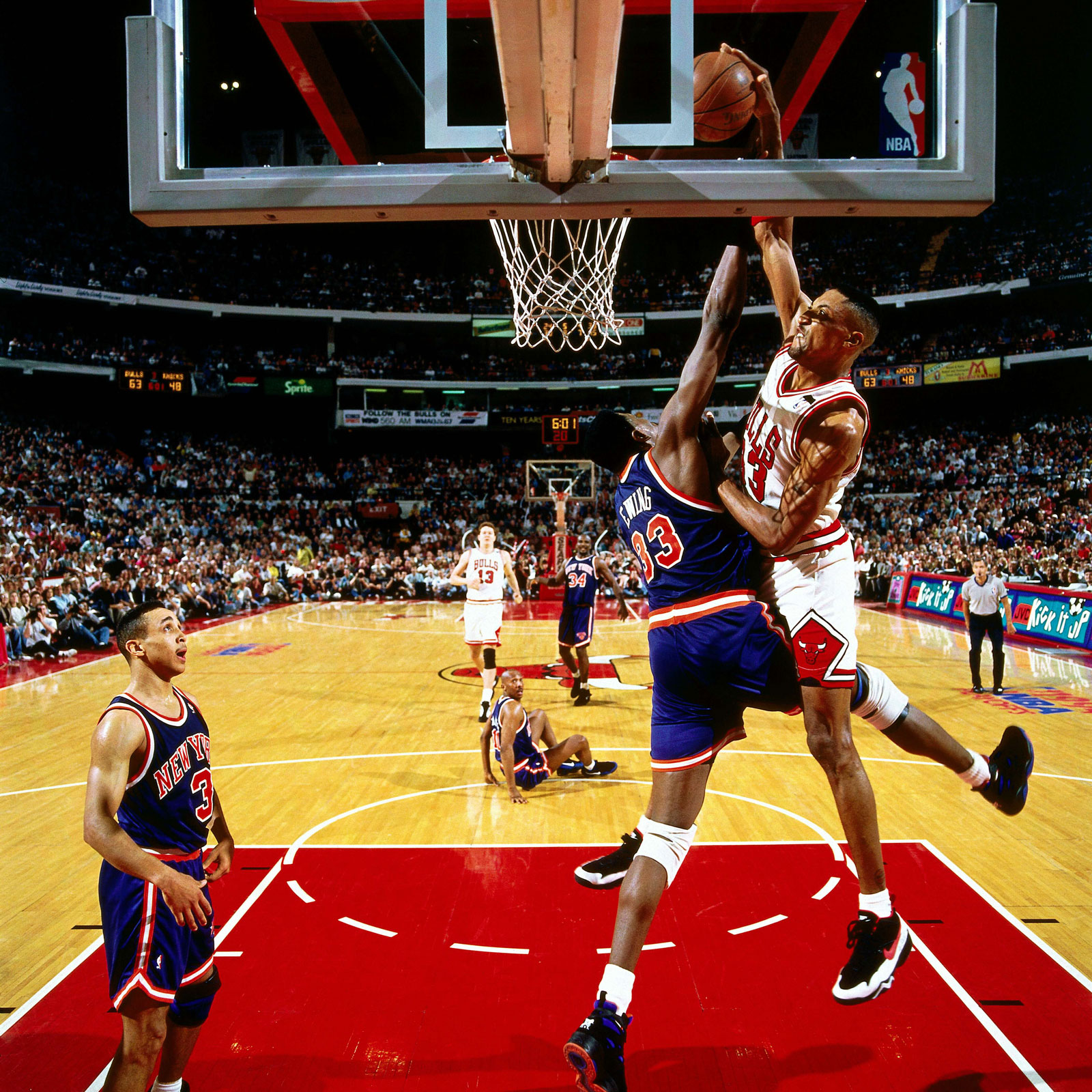 Pippen soars through the air and puts a poster on Patrick Ewing