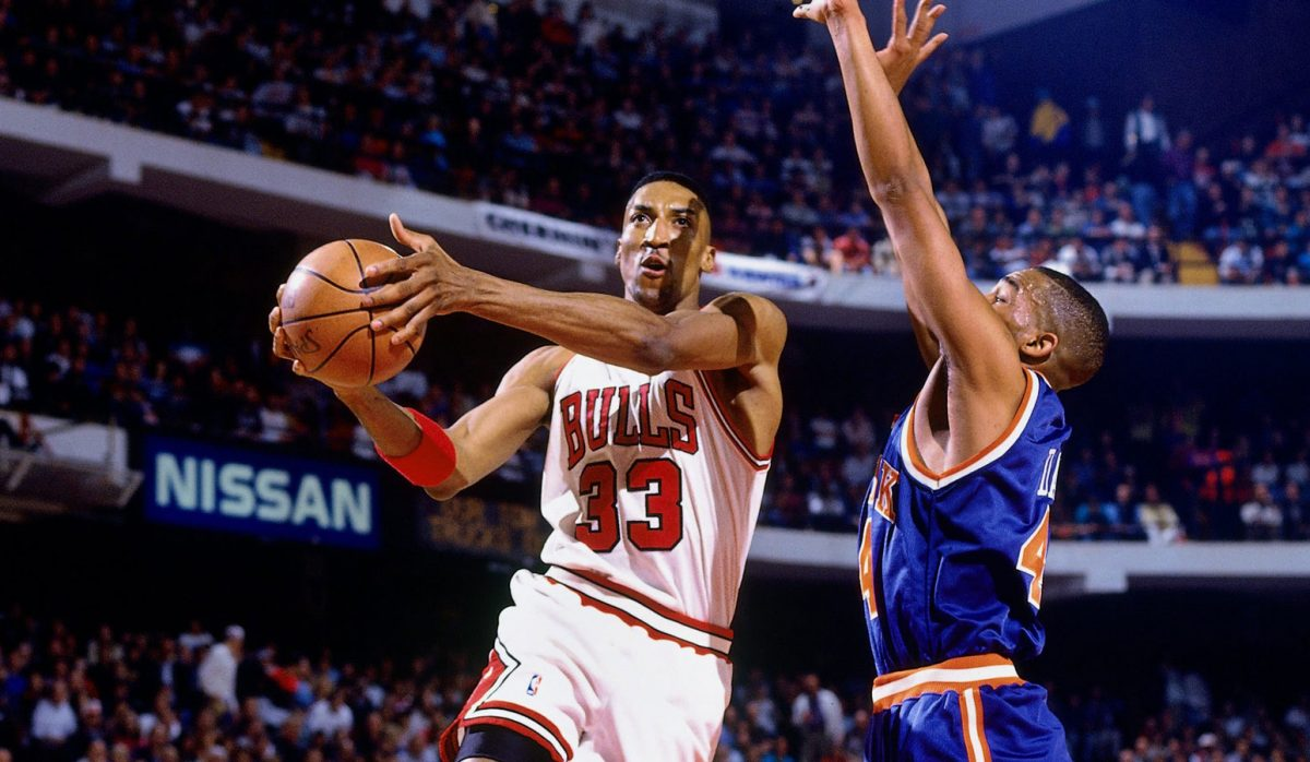 Scottie Pippen #33 of the Chicago Bulls goes up for a shot against Hubert Davis #44 of the New York Knicks in Game Three of the Eastern Conference Semifinals during the 1994 NBA Playoffs at Chicago Stadium on May 13, 1994 in Chicago, Illinois. The Bulls won 104-102.